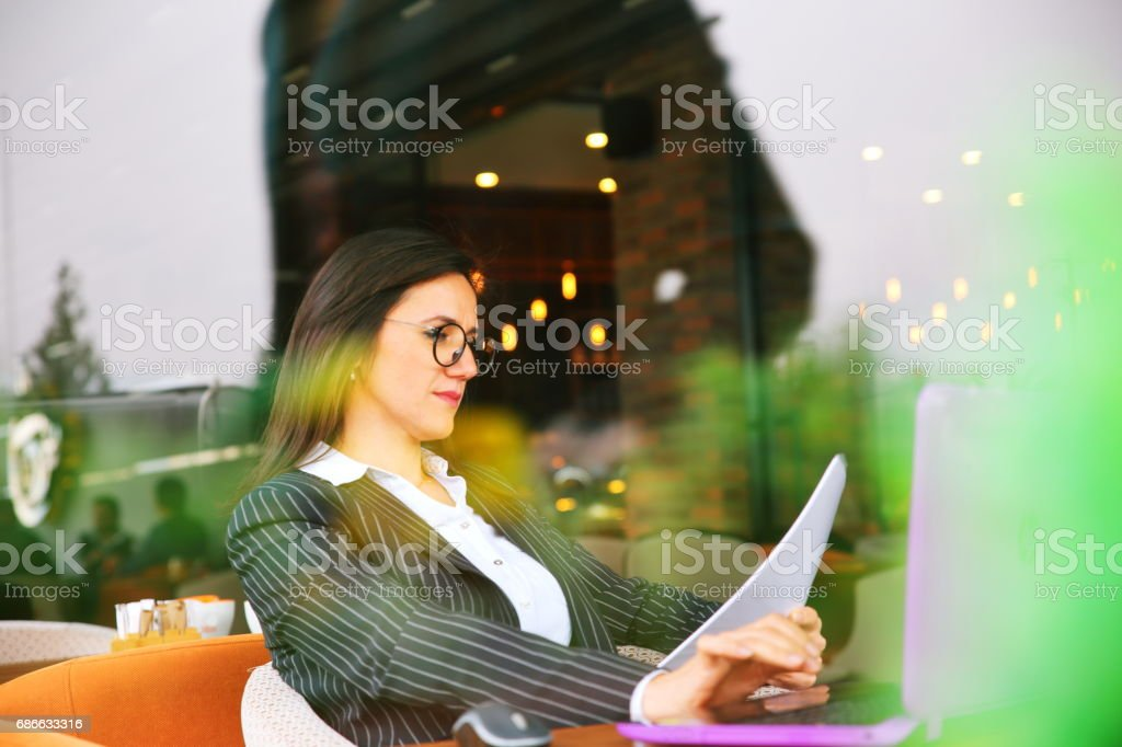 Business woman sitting in cafe royalty-free stock photo