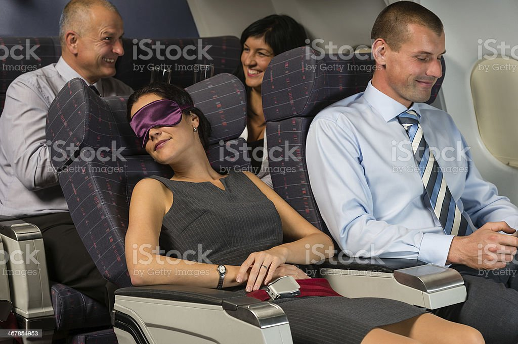 Business woman sleep during flight airplane cabin stock photo