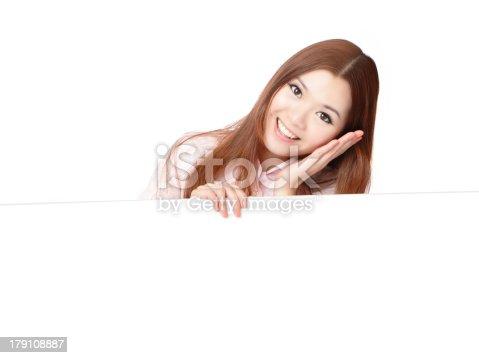 528291188 istock photo Business Woman Smile Showing blank billboard 179108887