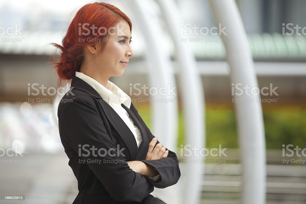 Business woman smiling arms crossed royalty-free stock photo
