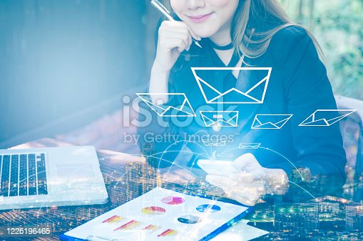 1016971522 istock photo Business woman smiling using smartphone sending email with smart city online connectivity, Big data 5g online concept 1225196465