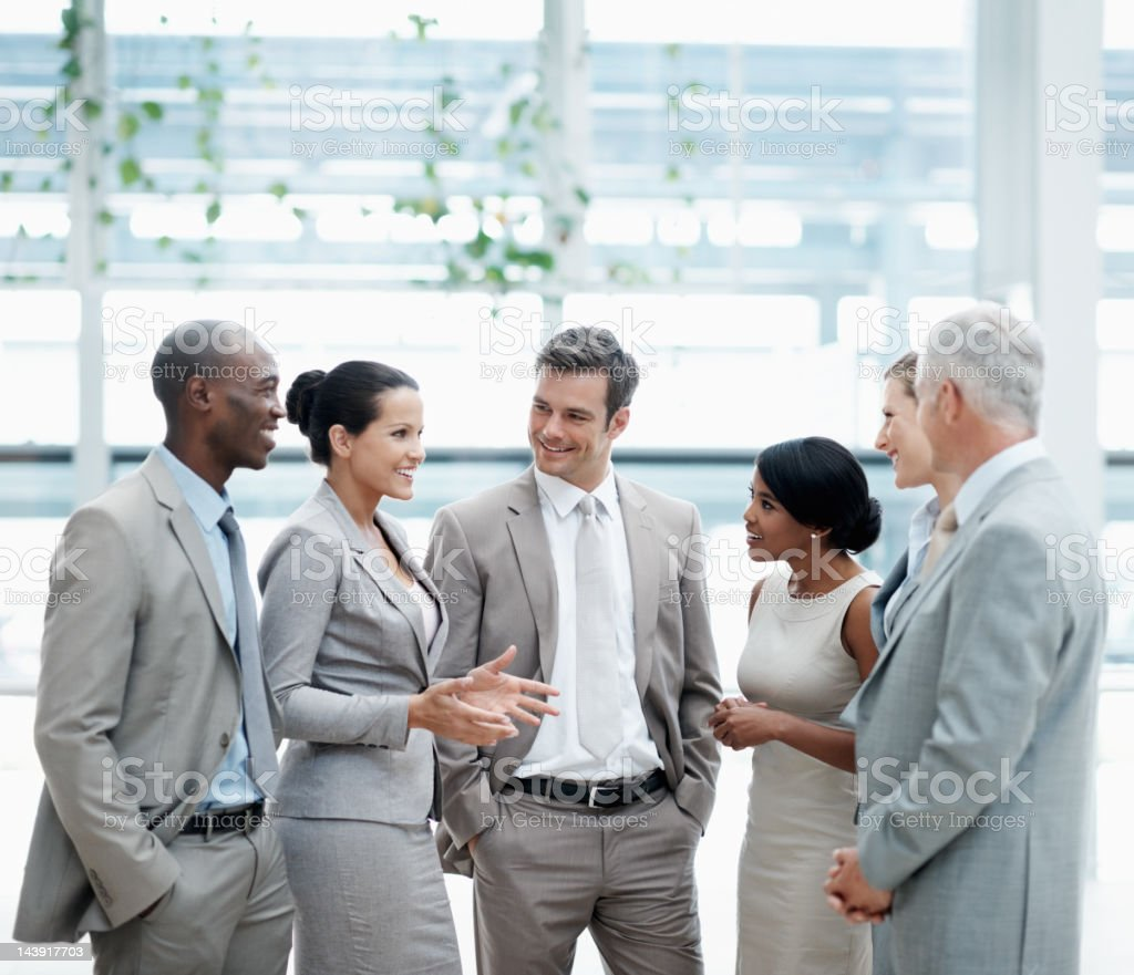 Business woman speaking with team royalty-free stock photo