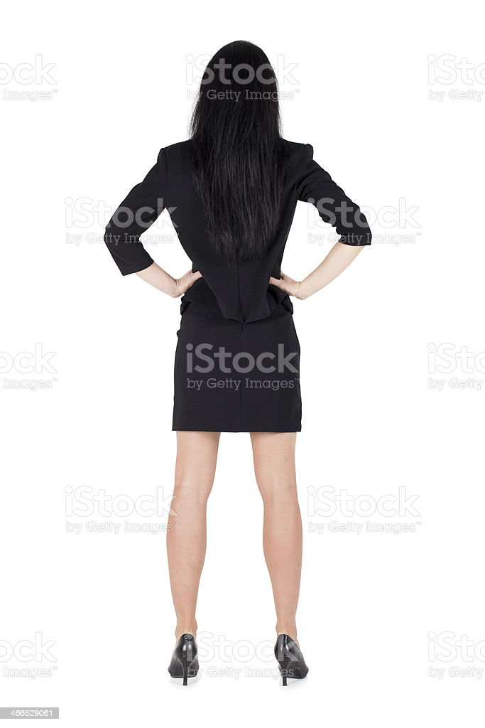 Business woman standing backwards hands on hips isolated stock photo
