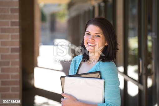 istock Business woman standing outside an office building. 509238636