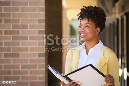 istock Business woman standing outside an office building. 509367720