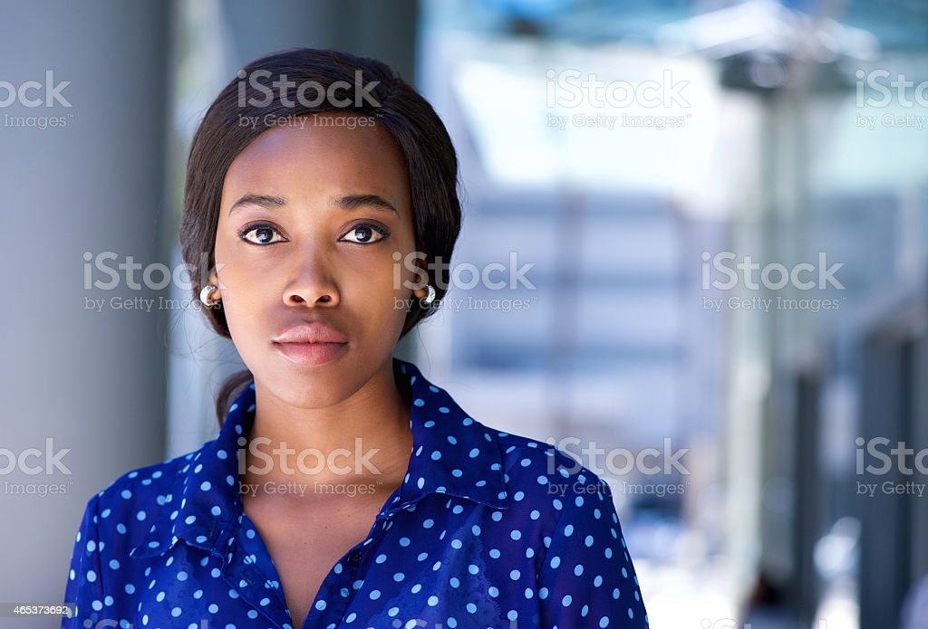 Business woman standing outside office building stock photo