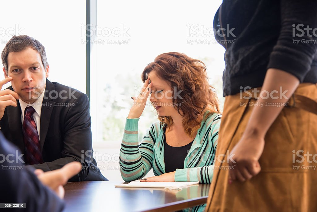 Business Woman Stressed During Team Meeting stock photo