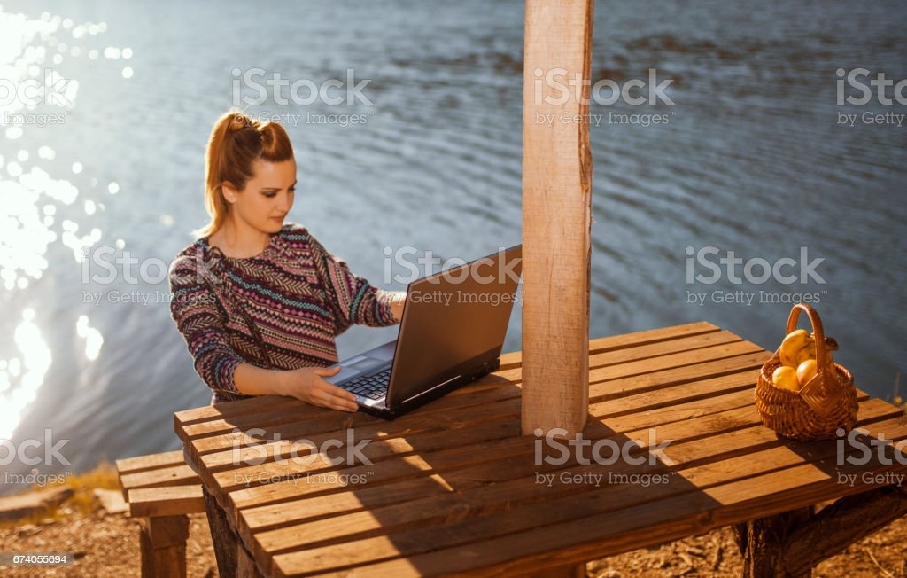 Business woman surfing the net in nature stock photo