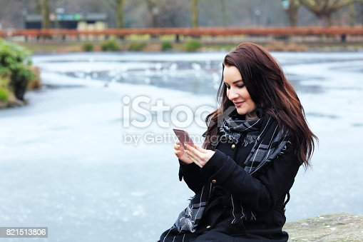 istock Business woman take a selfie in the public park 821513806