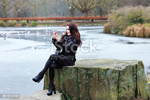istock Business woman take a selfie in the public park 821517242