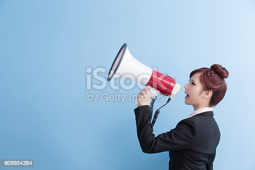 1166716628 istock photo business woman take microphone happily 609954384