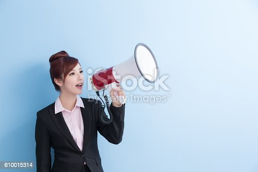 1166716628 istock photo business woman take microphone happily 610015314