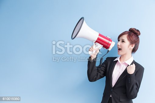 1166716628 istock photo business woman take microphone happily 610015350