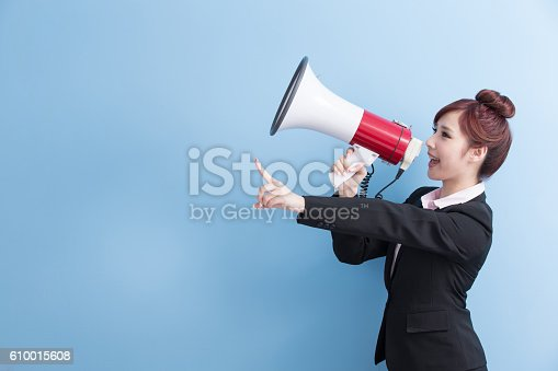 1166716628 istock photo business woman take microphone happily 610015608
