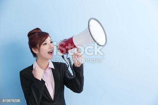 1166716628 istock photo business woman take microphone happily 610976206