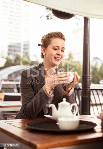 istock business woman takes a tea at cafè 187289182