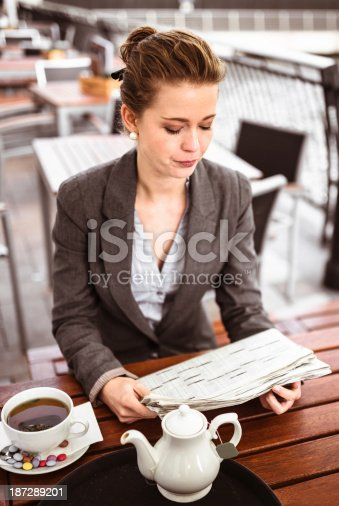 istock business woman takes a tea at cafè 187289201