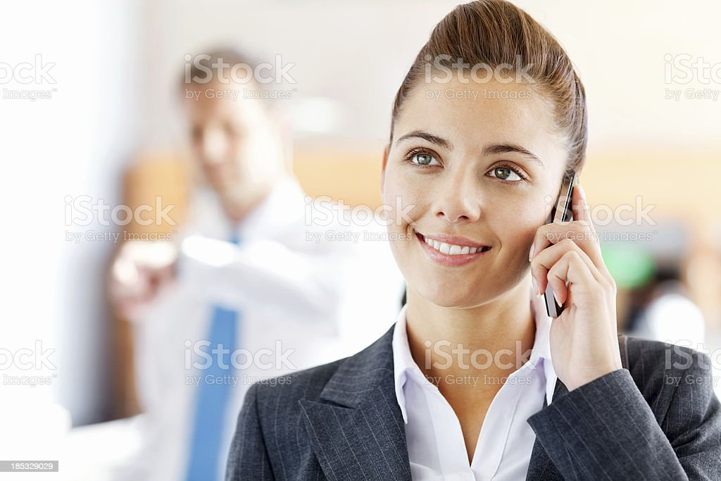 Business Woman Talking On Mobile Phone At Airport royalty-free stock photo