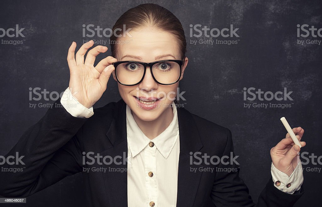 business woman teacher with glasses and  chalk royalty-free stock photo