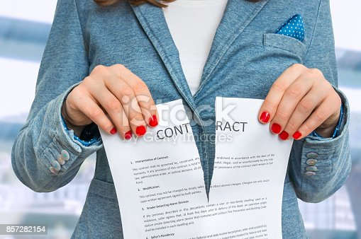 94113879istockphoto Business woman tearing contract in office 857282154