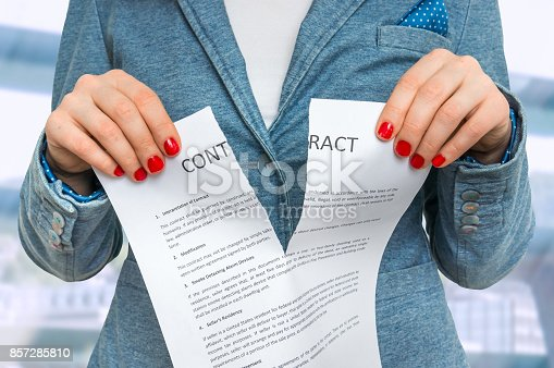 94113879istockphoto Business woman tearing contract in office 857285810
