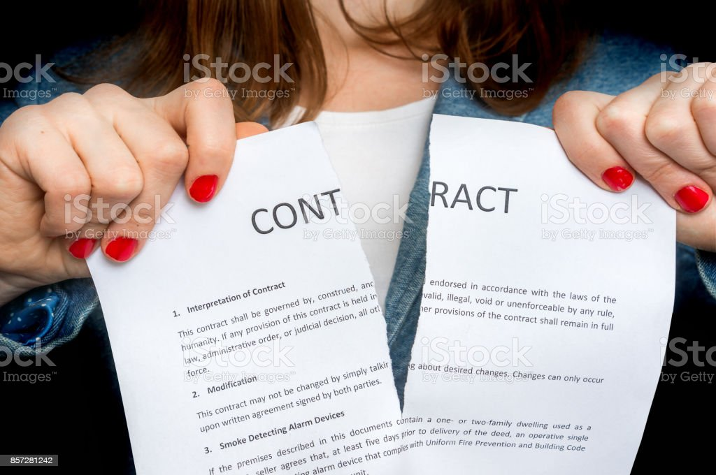Business woman tearing contract - isolated on black stock photo