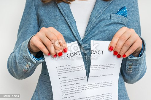 94113879istockphoto Business woman tearing contract 656915584