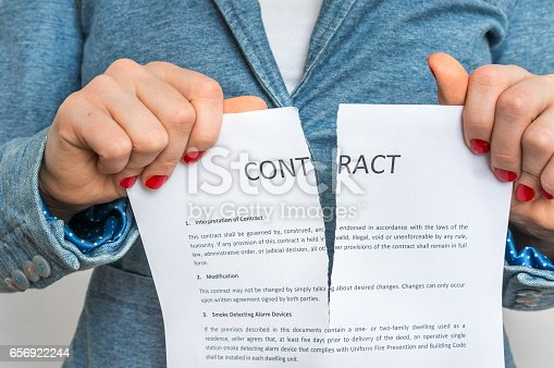 94113879istockphoto Business woman tearing contract 656922244
