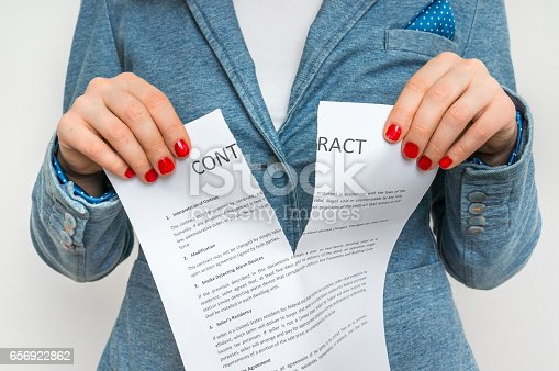 94113879istockphoto Business woman tearing contract 656922862