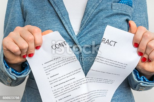 94113879istockphoto Business woman tearing contract 656923756