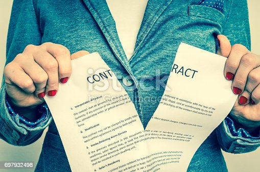 94113879istockphoto Business woman tearing contract 697932498