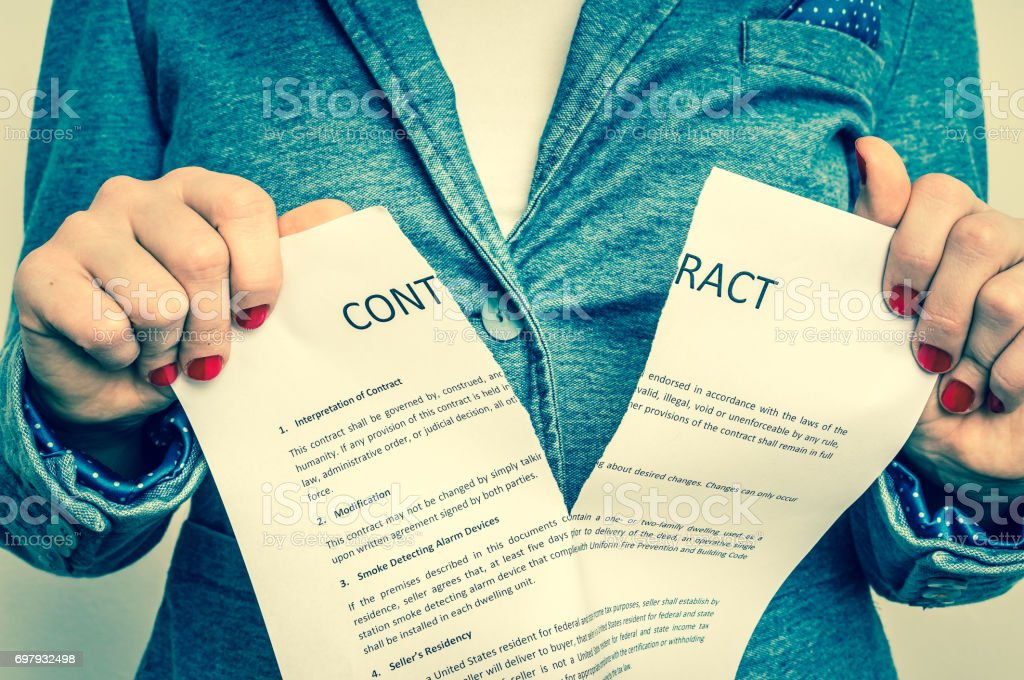 Business woman tearing contract stock photo