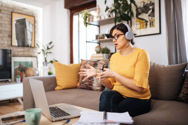 Business woman teleconferencing with employees stock photo