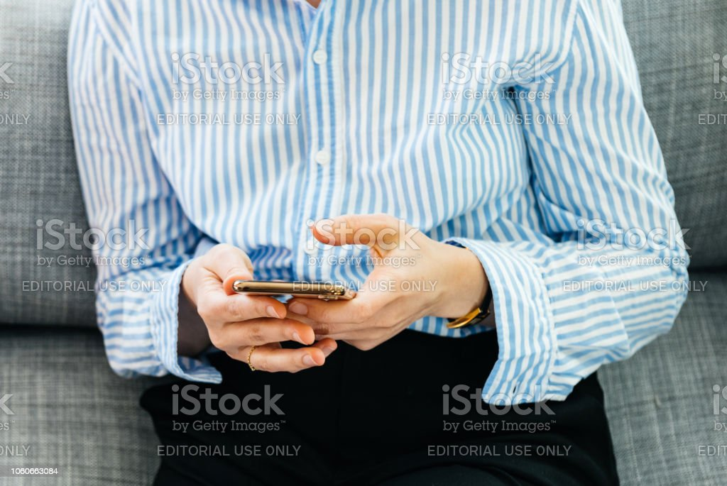 Business woman testing new iphone Xs Max Xr smartphone stock photo