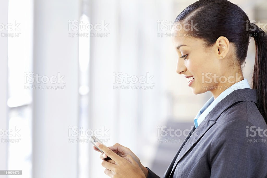 Business Woman Texting on a Cellphone royalty-free stock photo