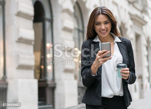 istock Business woman texting on her phone 513949462
