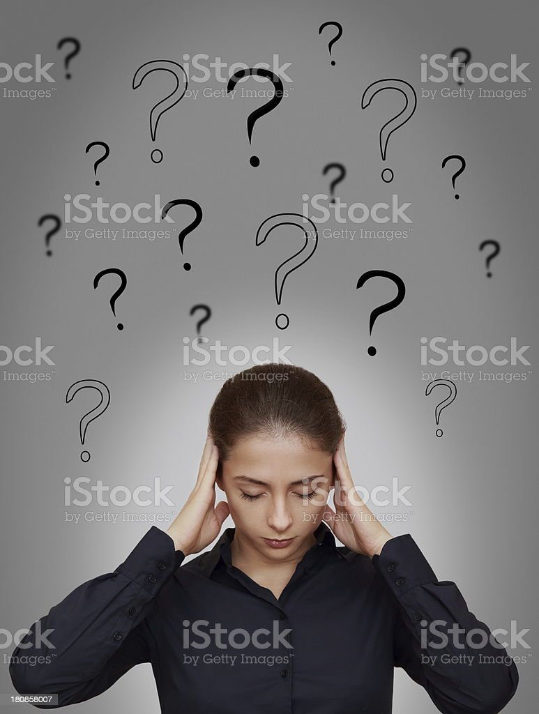 Business woman thinking hard with many questions above head royalty-free stock photo