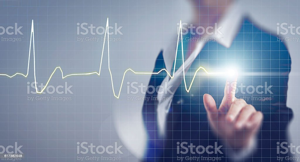Business woman touching the pulse screen stock photo