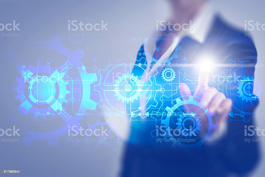 Business woman touching the screen of the mechanical gear Business woman touching the screen of the mechanical gear Activity Stock Photo
