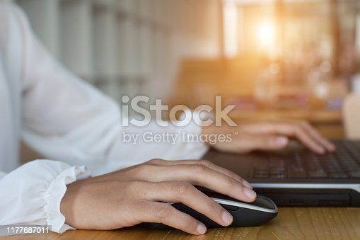 business woman typing with laptop.working at coffee shop.Prepare a proposal to the Special Project Director.