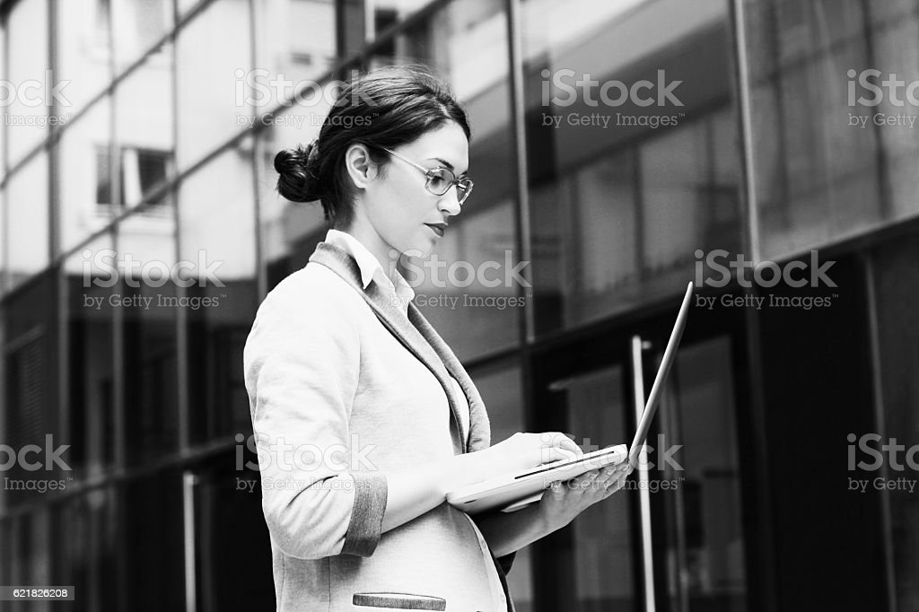 Business woman using laptop BNW - Photo