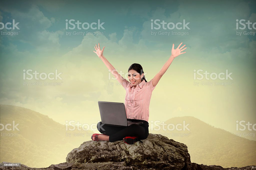 Business Woman Using Laptop On The Mountain stock photo
