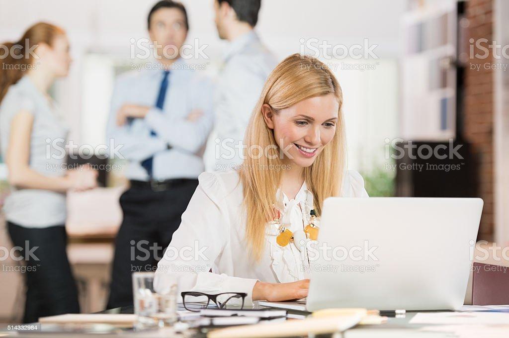 Business woman using laptop stock photo