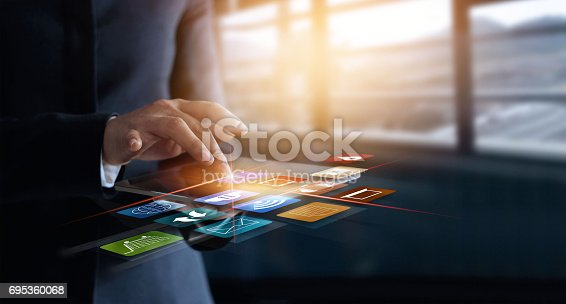 business woman using mobile payments online shopping and icon customer network connection on virtual screen, m-banking and omni channel