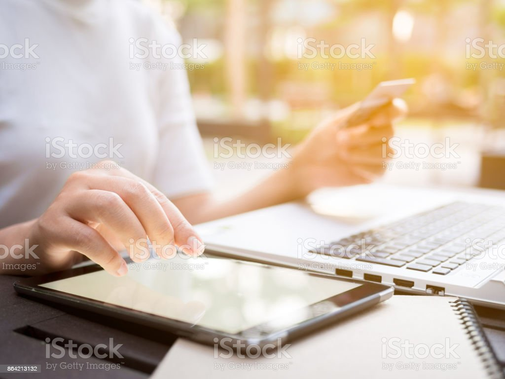 Business woman using smart phone tablet, credit card and laptop for online shopping, online payment, network internet banking royalty-free stock photo