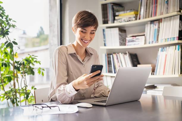 Business woman using smartphone stock photo