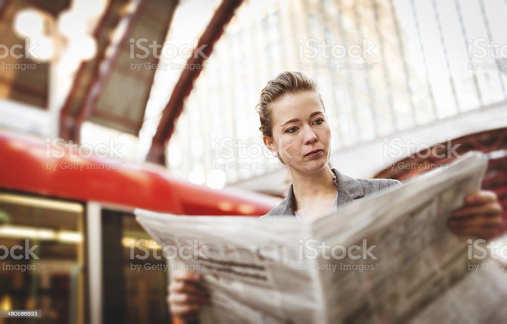 Business woman waiting the train on railway station stock photo