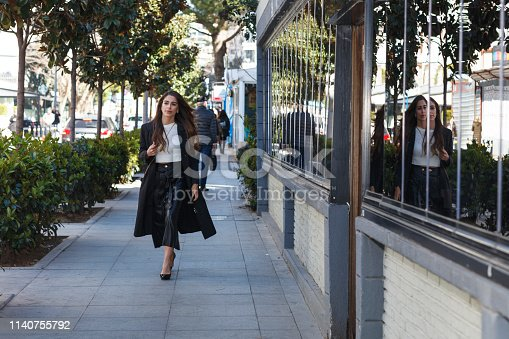 Young businesswoman going to work