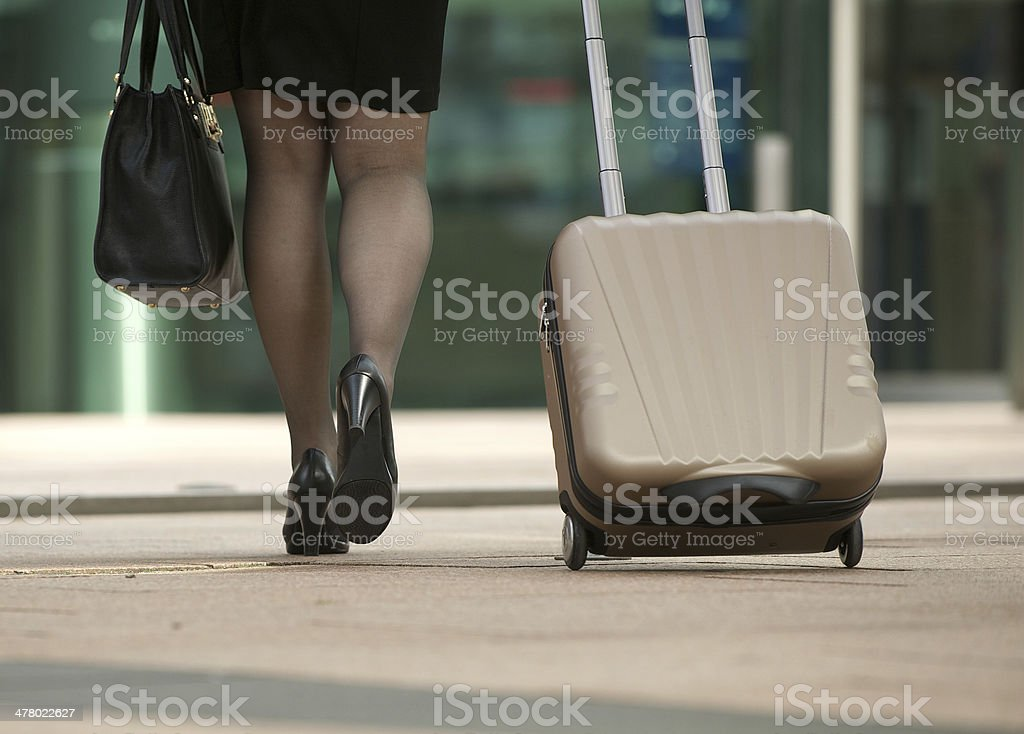Business woman walking with bag and suitcase royalty-free stock photo