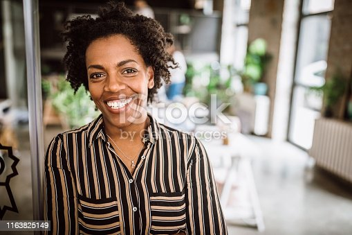 Portrait Of Cheerful Business Woman Standing at Office